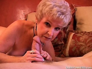Gorgeous cougar sucks cock..